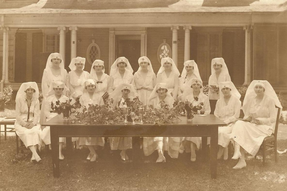 Beth McCune 3rd from right seated 1917 graduated from Red Cross.
