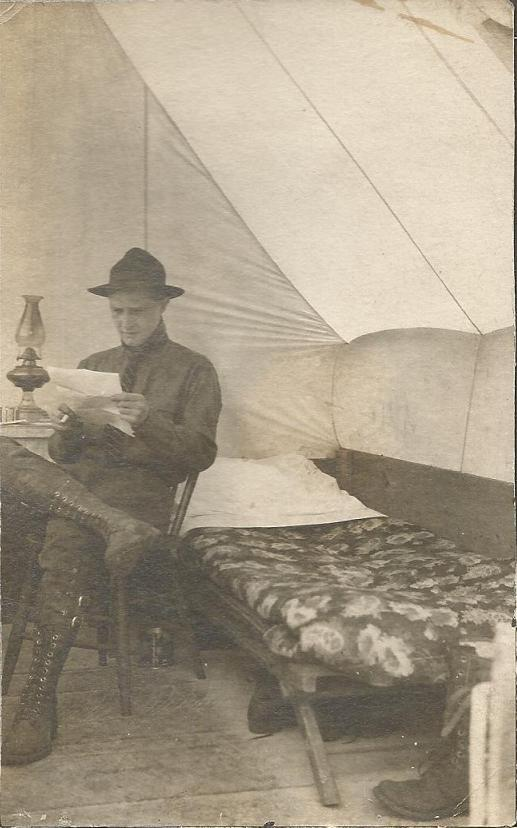 Marcus McCune WWI probably reading letters from home.