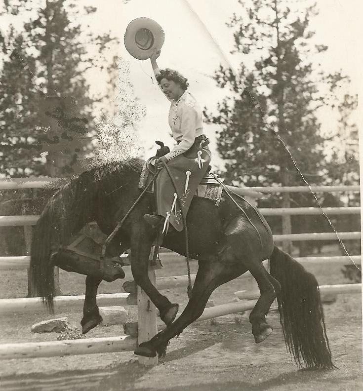 Beth Fisher on fake bronco horse West Yellowstone MT.