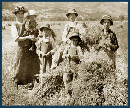Lillian Waddell on family farm, Tabiona, Utah with children, Andrew, Wallace, Lamar, Ronald, and Olaus